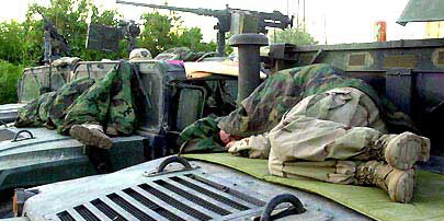 Brian Horn's regiment spent nearly a year finding places to sleep on the ground or on their vehicles while behind enemy lines in Northern Iraq. From Life in Iraq, Stars and Stripes special report on morale. October, 2003, Jon R. Anderson, Stars and Stripes